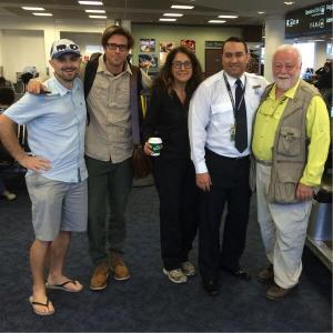 Mike, Dan, Amy, and Fred pose with a security guard at the airport on their way to the rainforests of Nicaragua.